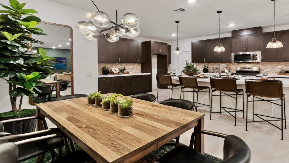 Haven at Canopy Grove Residence 4 Dining Room:The spacious dining room offers effortless flow into the kitchen and Great Room, making multitasking