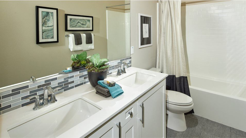 The Peak at Delpy's Corner Residence 2 Bathroom 2:A bathroom situated near two secondary bedrooms features dual sinks and a full-width vanity mirror.
