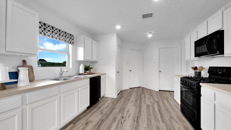 Country-Colony nuHome Collection La Mirada Kitchen:The spacious kitchen boasts a complete set of brand-new appliances and stylish flooring. An ample su