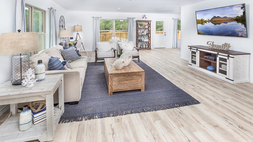 Country-Colony nuHome Collection San Marcos Family:As the heart of this home, the spacious family room offers an ideal space for relaxing with loved on