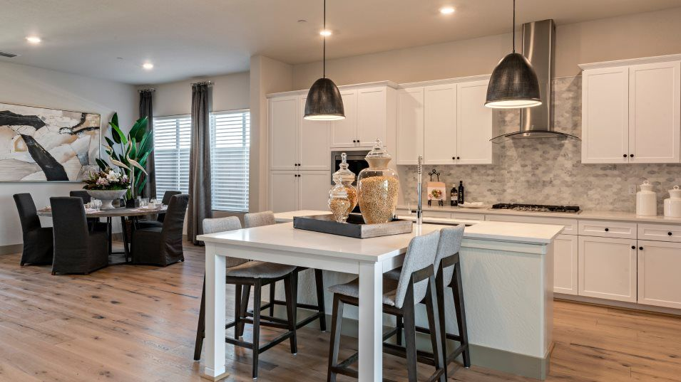 Ironsides Skye Series Alpenglow Kitchen:In a shared open layout with the dining room, the gourmet kitchen boasts an oversized center island