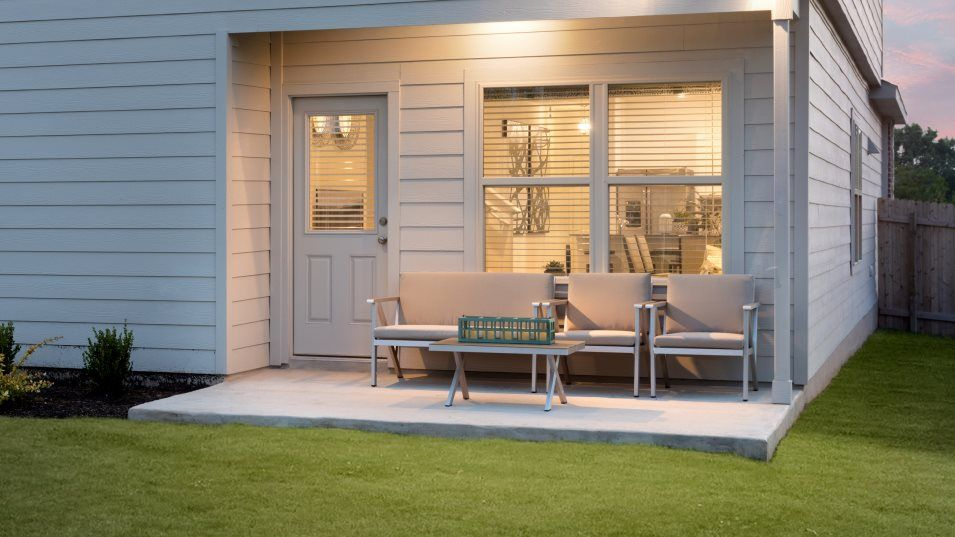 Saddlecreek Claremont Collection Brock Outdoor Spa:A covered patio meets exposed outdoor space for a comfortable spot to relax with a book, enjoy sunny