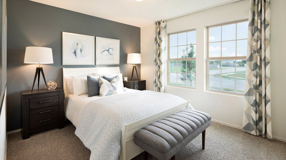 Saddlecreek Highlands Collection Catesby Bedroom 3:Two secondary bedrooms are situated near the front of the home with a bathroom tucked between them,