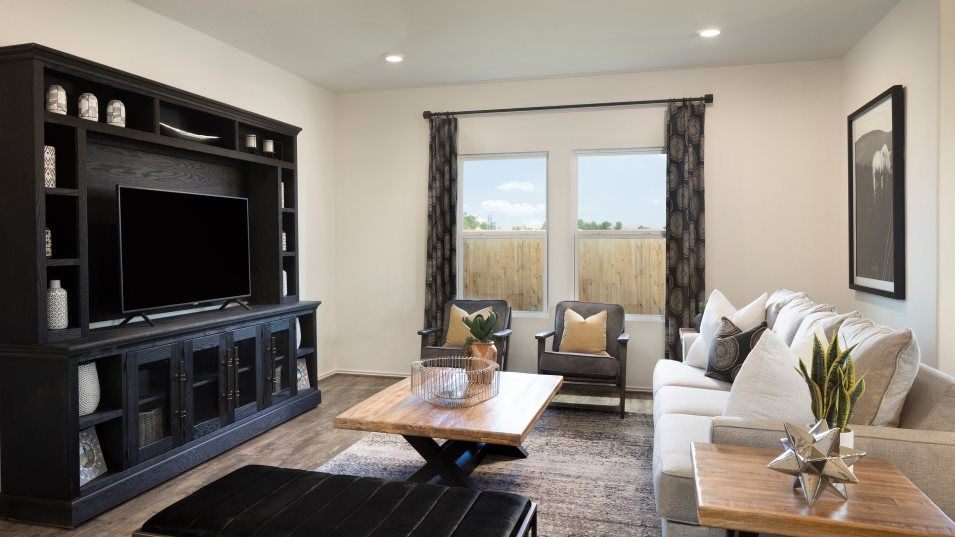 Saddlecreek Highlands Collection Hudson II Family:A comfortable family room is an ideal space to relax with loved ones, situated conveniently among th