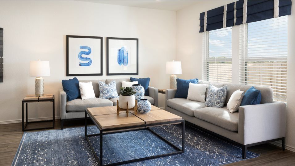 Greenwood Watermill Collection Nettleton Living Ro:A sunlit living room is a cozy retreat that the entire family will enjoy.