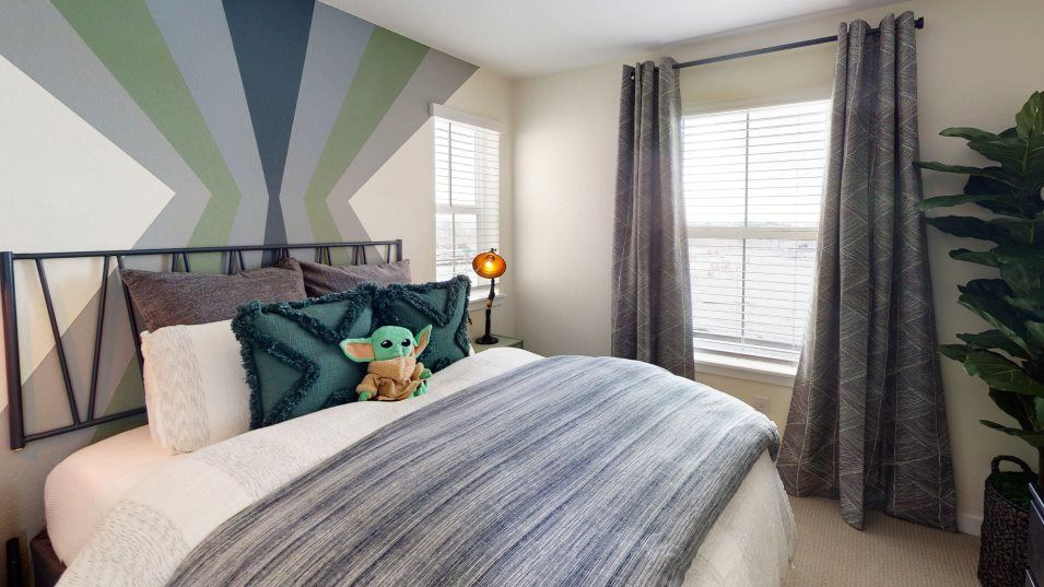 Mosaic Paired Homes Vibrant Bedroom 3:With four bedrooms in total, this home is ideal for families who need space.