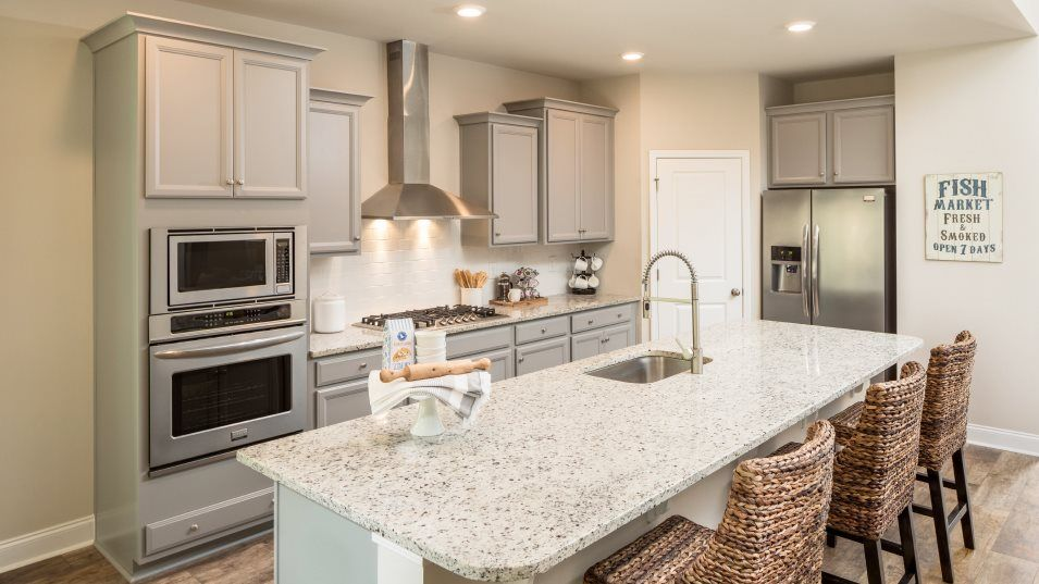 Forestbrook Estates LEXINGTON Kitchen:This modern kitchen, depicted here with the optional gourmet layout, features a center island with a
