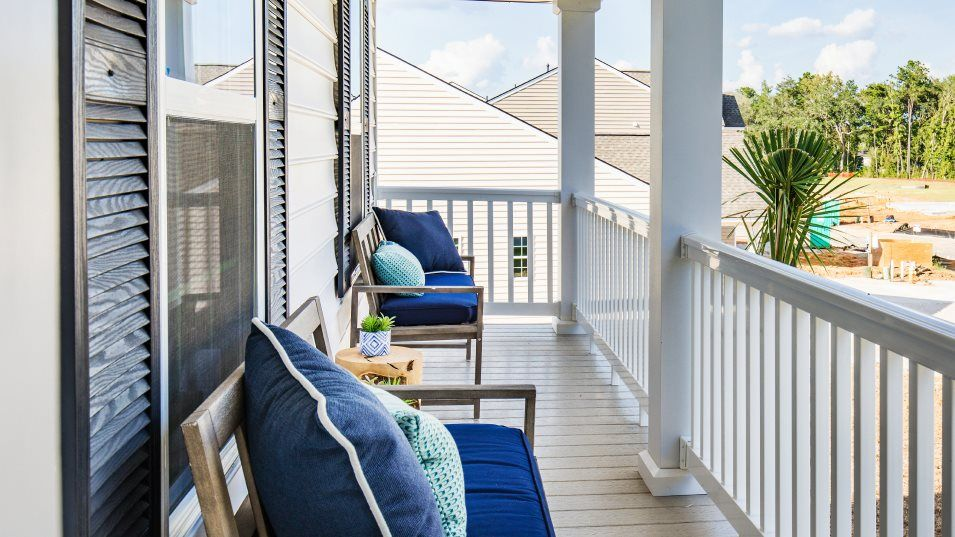 Lindera Preserve at Cane Bay Plantation Arbor Coll:A charming front porch and back patio provide plenty of spaces to enjoy the outdoors from the comfor