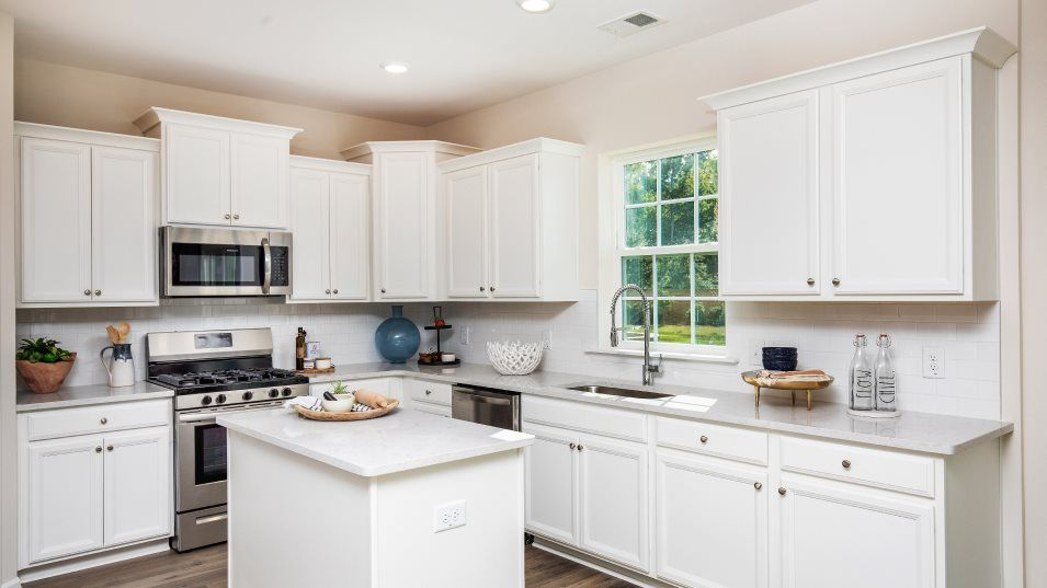 Lindera Preserve at Cane Bay Plantation Arbor Coll:Designed for convenience, this kitchen features a center island with granite countertops, designer-s