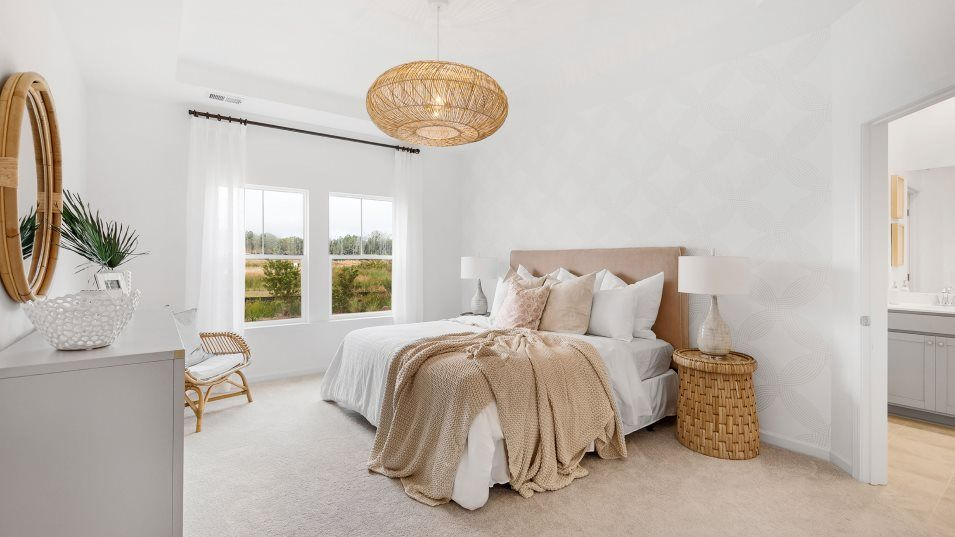Waterside at Lakes of Cane Bay Waterfront Coastal:This airy owner's suite enjoys a full-sized bathroom with a luxurious glass-enclosed shower, double