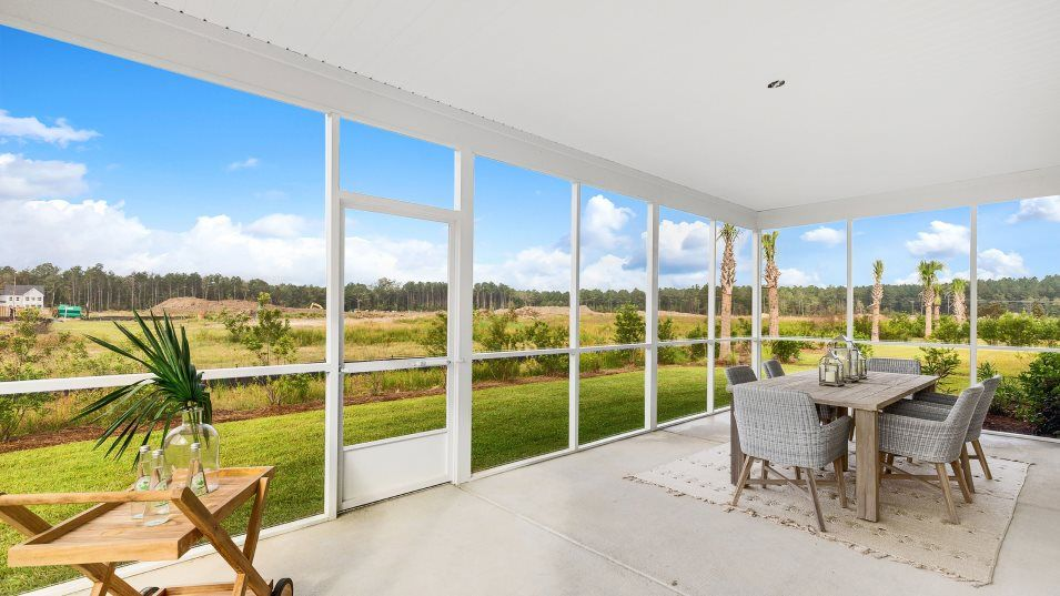 Waterside at Lakes of Cane Bay Waterfront Coastal:This inviting covered space comes with the option for a screened in porch and is ready for outdoor m