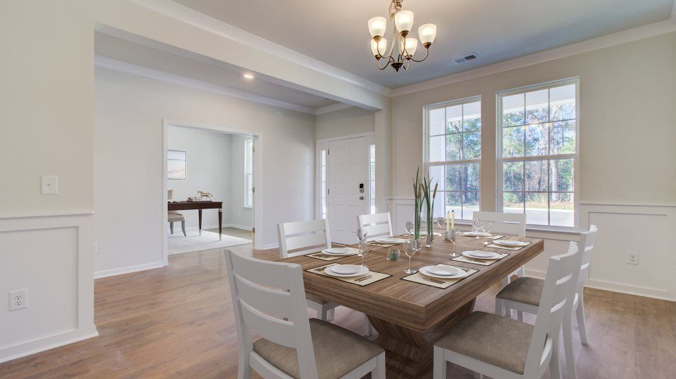 Waterside-at-Lakes-of-Cane-Bay Coastal Collection:Partially secluded from the home is a formal dining room that offers an intimate atmosphere for spec