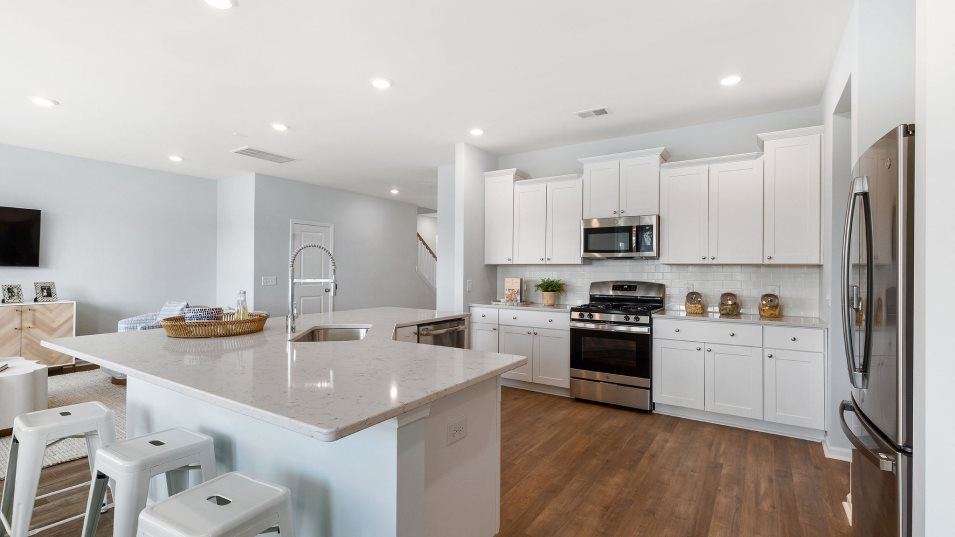 Summers-Corner Azalea Ridge - Arbor Collection FAN:This modern kitchen is stocked with an angular center island, granite countertops, a roomy pantry an