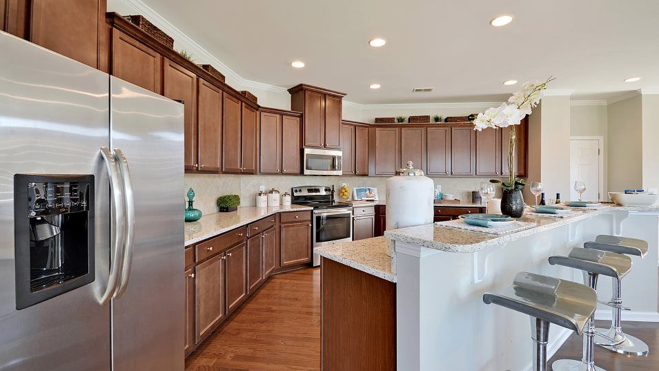 Summers-Corner Azalea Ridge - Arbor Collection GEO:The expansive kitchen enjoys a spacious, airy layout with extensive countertop space, designer-selec