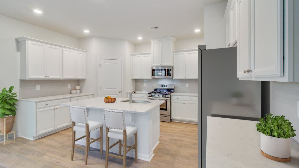 Summers-Corner Azalea Ridge - Arbor Collection TAY:The stylish kitchen features a sparkling center island with granite countertops, designer-selected c