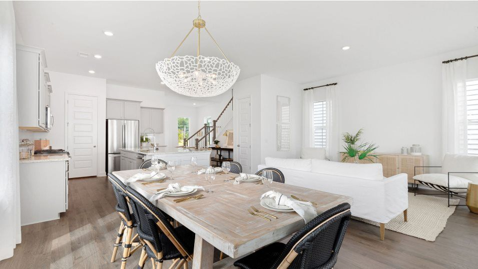 Summers-Corner Azalea Ridge - Row Collection ELLIO:Tucked to the side of the family room is a formal dining area for meals of any occasion, from casual