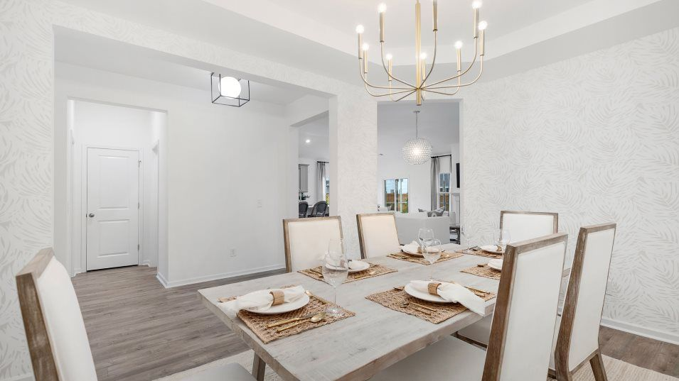 Summers Corner Azalea Ridge - Coastal Collection C:A formal dining room is ready for meals of any occasion, from family dinners to holidays with extend