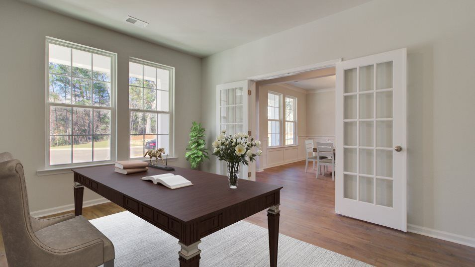 Summers-Corner Azalea Ridge - Coastal Collection F:Overlooking the front yard, a formal living room is ideal for entertaining guests, a quiet reading a
