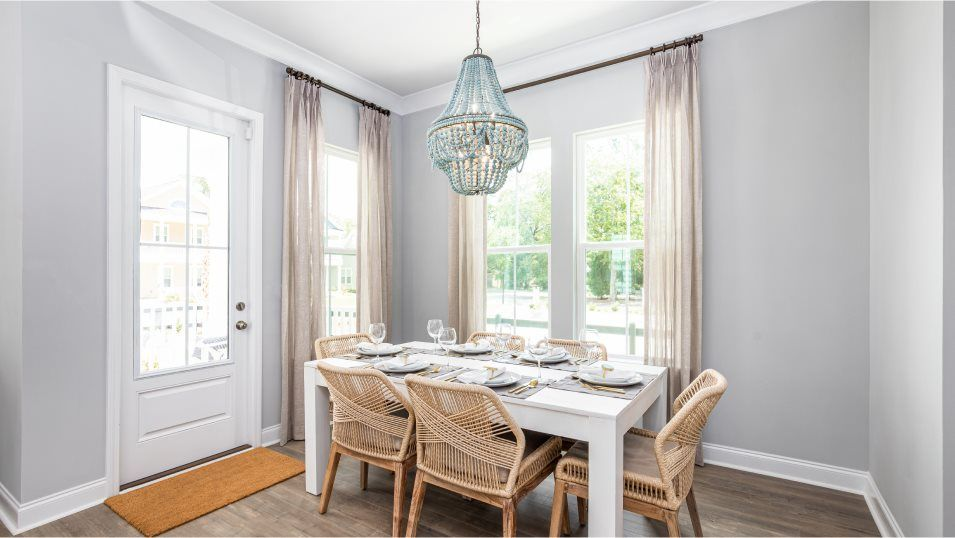 Summers Corner The Village - Row Collection RUTLED:Tucked to the side of the kitchen is a dining space ready for meals both casual and celebratory