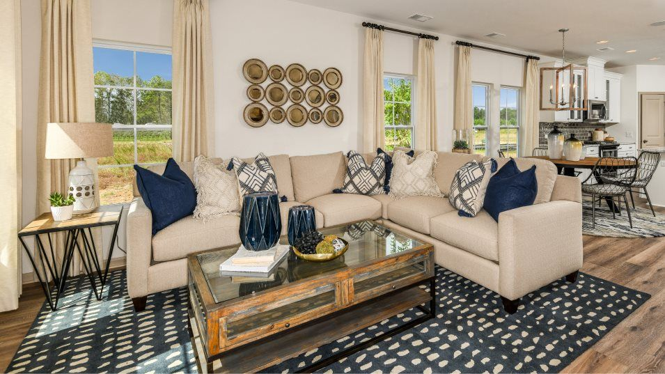 Brunswick Plantation Azalea Family Room:Situated at the end of the foyer, this bright living space welcomes the family to lounge around in a