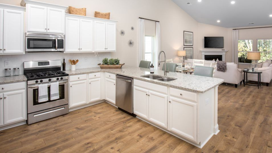 Brunswick Plantation ANNANDALE Kitchen:With ample room to move around in, a flexible kitchen island with granite countertops, stainless ste