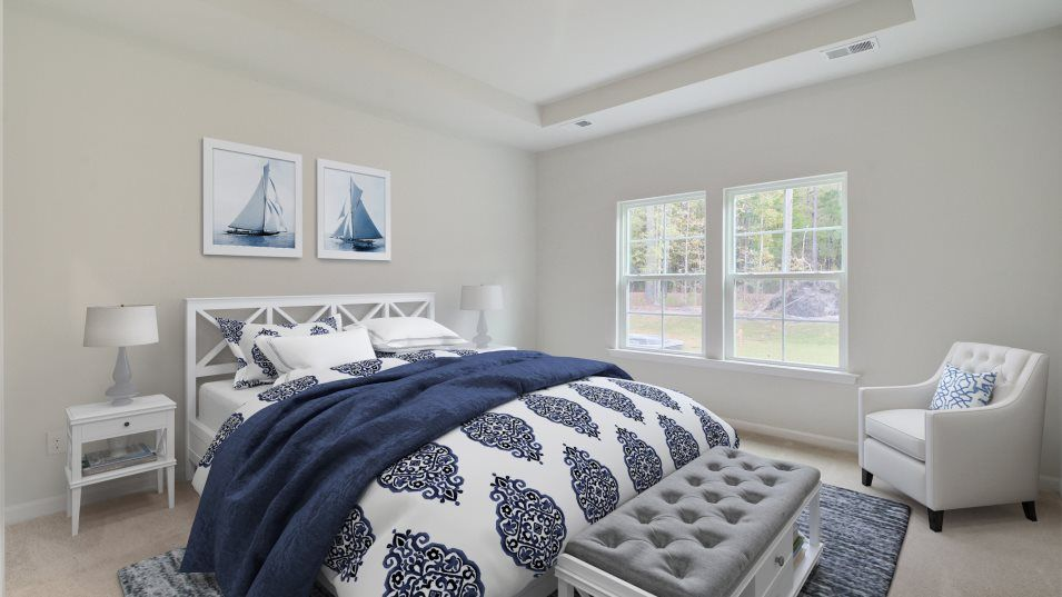 Waterside at Lakes of Cane Bay Arbor Collection BE:n a private corner of the home, the owner's suite hosts a comfortable bedroom ideal for relaxation,