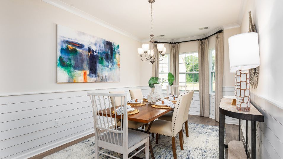 Waterside-at-Lakes-of-Cane-Bay Arbor Collection HA:A formal dining room provides a location for meals of any occasion, from family dinners to holidays
