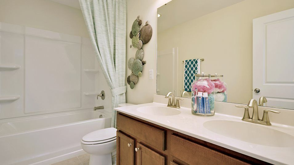 Waterside at Lakes of Cane Bay Waterfront Coastal:A full-sized bathroom on the second floor is thoughtfully placed next to two secondary bedrooms