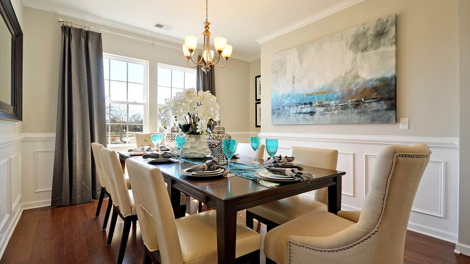 Waterside at Lakes of Cane Bay Waterfront Coastal:A formal dining room is a luxury feature of the home, providing space for family get-togethers and h
