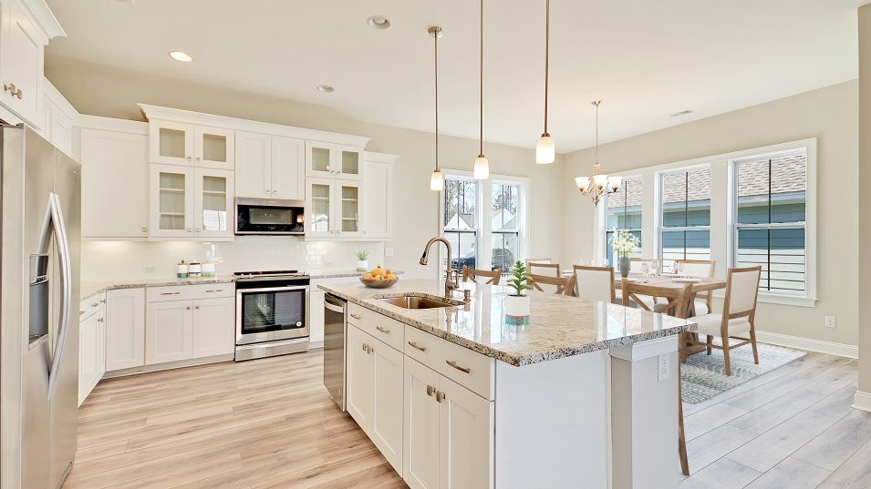 Carolina Park Phase 10 & 12 Thompson Kitchen:This kitchen features a center island that doubles as a breakfast bar, designer-selected cabinetry w