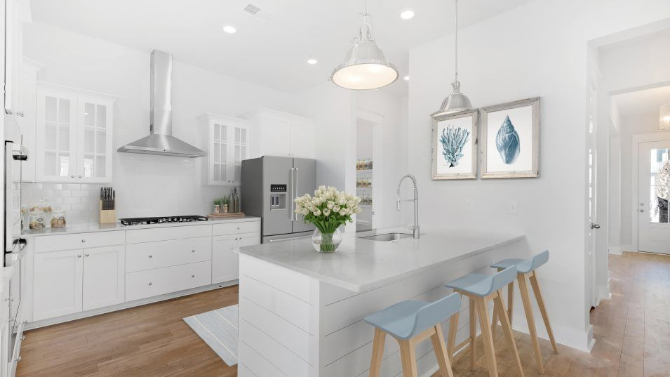 Carolina Park Phase 10 & 12 Beaufort Kitchen:For easy family meals, this kitchen features a center island that doubles as a breakfast bar, design