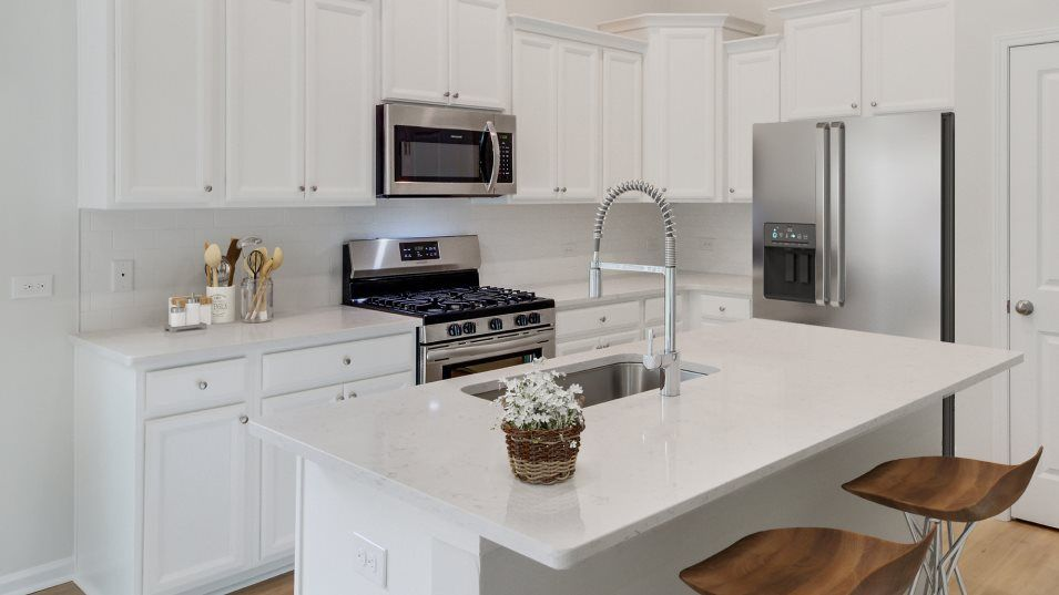 Limehouse Village Arbor Series Belhaven Kitchen:This modern kitchen offers a stunning center island that doubles as a breakfast bar, stylish Timberl