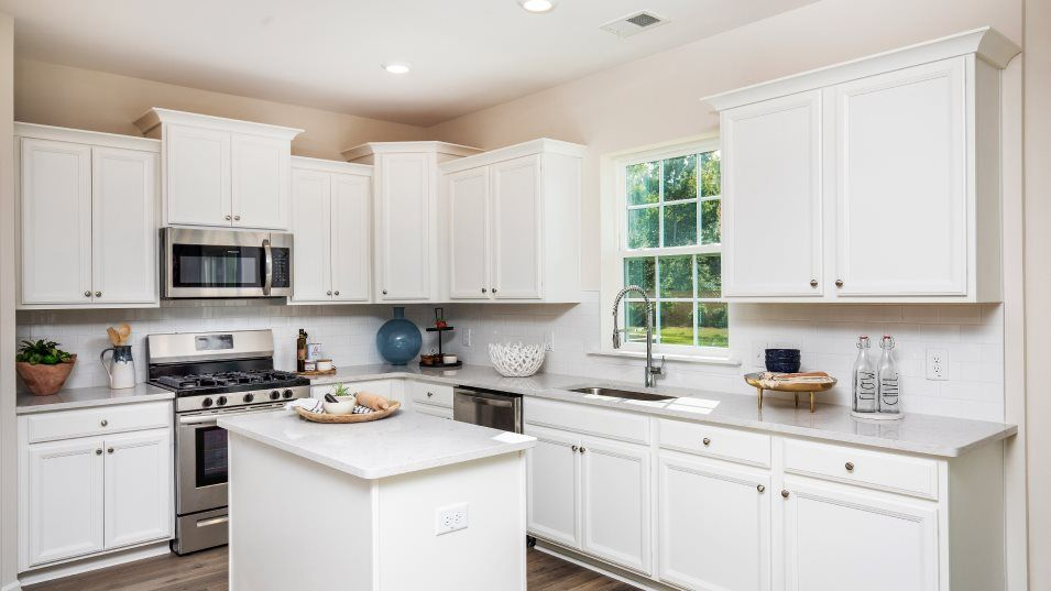 Limehouse Village Arbor Series HANOVER Kitchen:Designed for convenience, this kitchen features a center island with granite countertops, designer-s