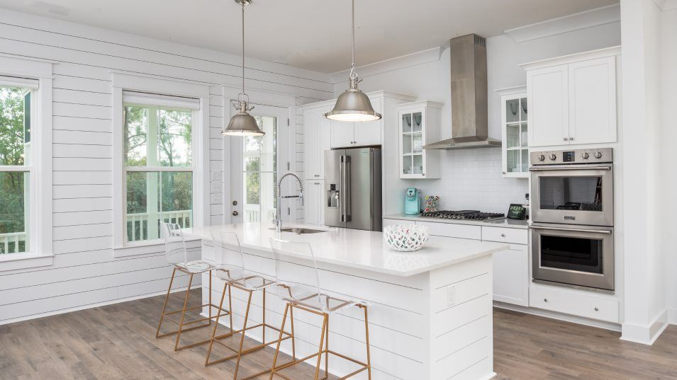 Limehouse Village Row Collection ANGLER Kitchen:Overlooking the sun-drenched breakfast nook, this kitchen features a center island with stunning gra