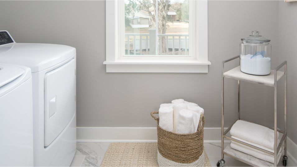 Limehouse Village Row Collection CALHOUN Laundry:The laundry room helps keep the home organized by providing a location to get chores finished and ke
