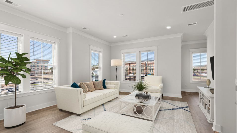 Midtown Townhomes Coleman Living Room:Surrounded by windows for plenty of natural daylight, this second-floor living room has an open layo