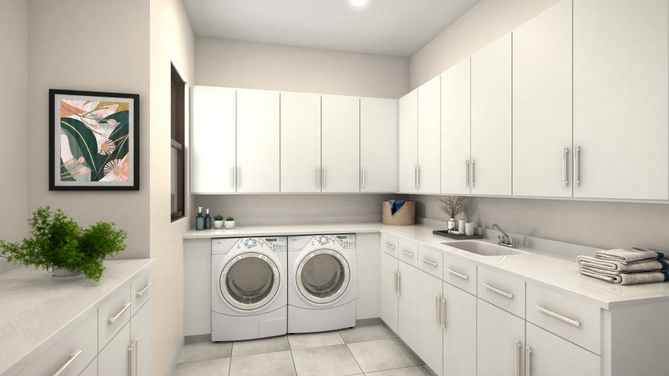 Sierra Ranches Addison Laundry Room:A spacious laundry room features a washer and dryer hookup and ample cabinetry storage to help keep