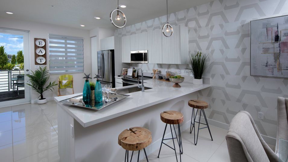 Landmark Condominiums Model F Kitchen:Durable quartz countertops, stainless steel appliances and a practical pantry come together to creat