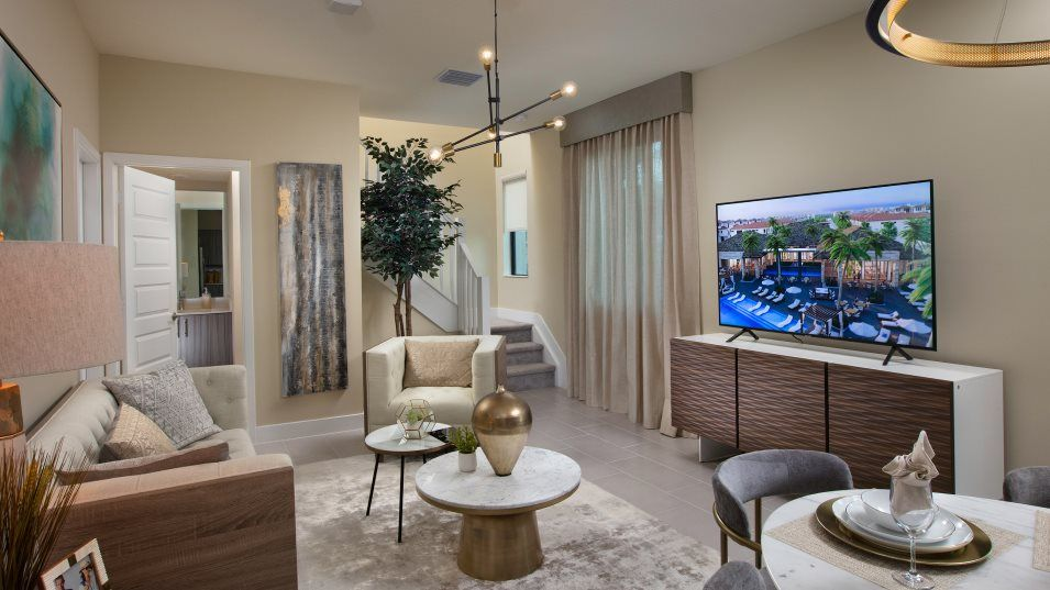 Urbana 2-Story Townhomes Model CC Family Room:The family room effortlessly flows into the kitchen and dining room, providing a comfortable retreat
