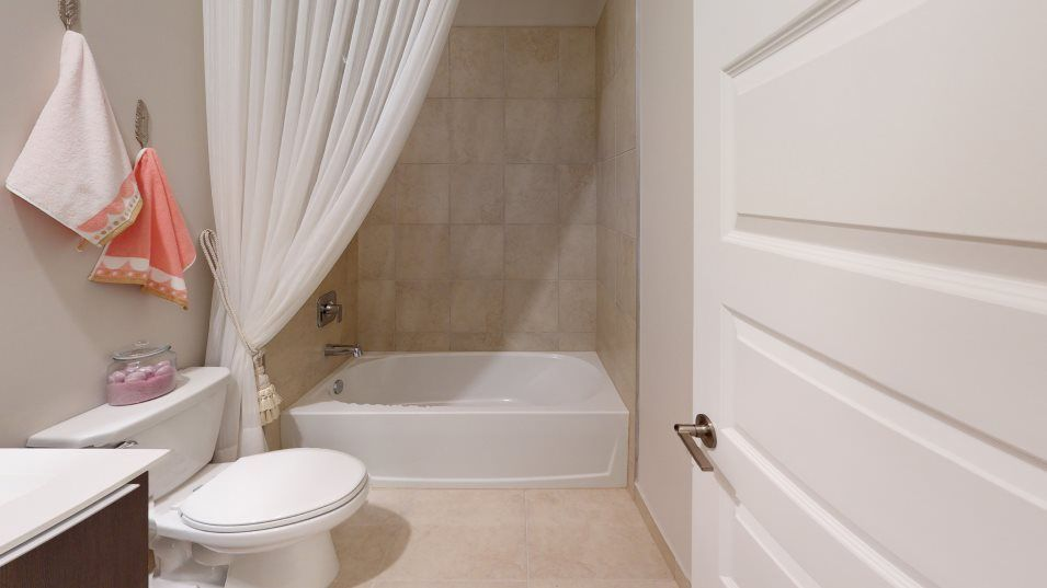 Urbana 2-Story Townhomes Model CG Bathroom 2:The en-suite bathroom is equipped with a shower-tub combination.