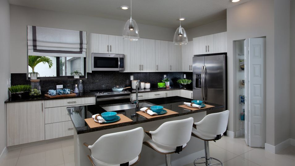 Urbana 2-Story Townhomes Model CE Skyview Kitchen:This multifunctional kitchen features generous countertop space, a convenient center island and dura
