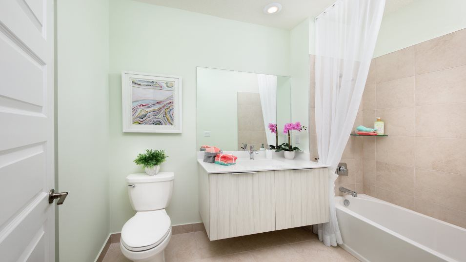 Urbana 4-Story Townhomes Model LA Bathroom 2:The en-suite bathroom includes a stylish floating vanity and a shower-tub combination.