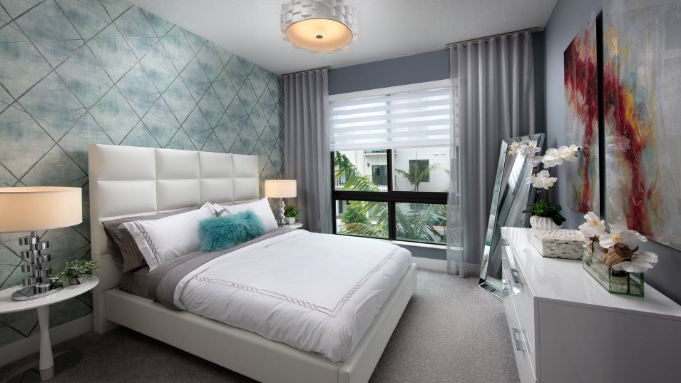 Urbana Midrise Condominium Residences Model MI Bed:Two secondary bedrooms are located upstairs, just down the hall from the owner's suite.