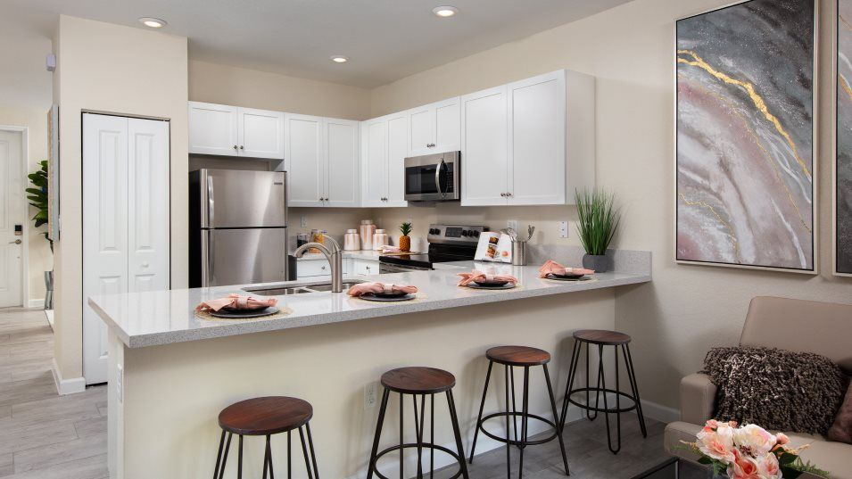 AquaBella The Harbor Collection Belmar Kitchen:This U-shaped kitchen offers ample countertop space and a practical pantry, so everything is both wi