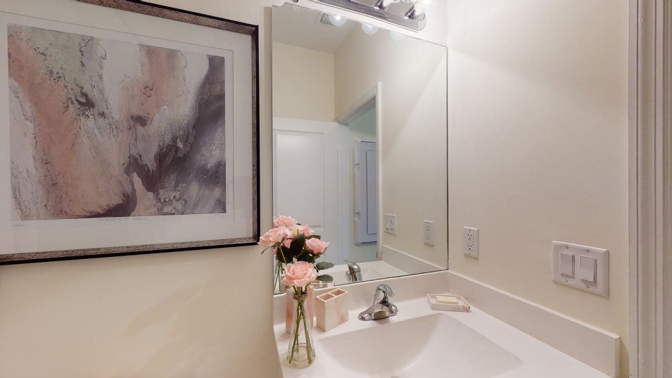 Venezzia Casis Bathroom 2:A full-width vanity mirror and cultured marble countertops can be found in the second-floor full bat