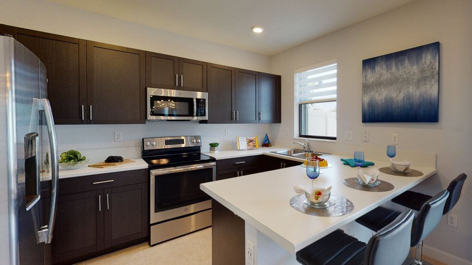 Venezzia Monte Carlo Kitchen:Featuring ample countertop space, stainless steel appliances and easy-care mica countertops, this ki