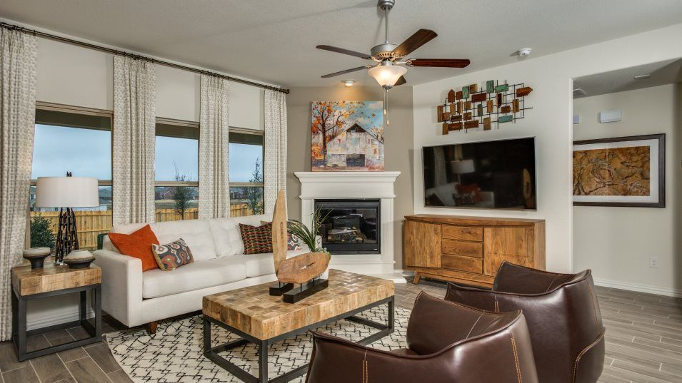 Sendera-Ranch Classic Sonata  -STANDARD 3 CAR GARA:The family room has everything you need to relax or entertain, with ample space for furniture, great