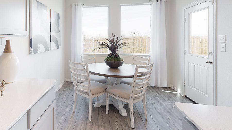 The open concept living area features a sunlit bre