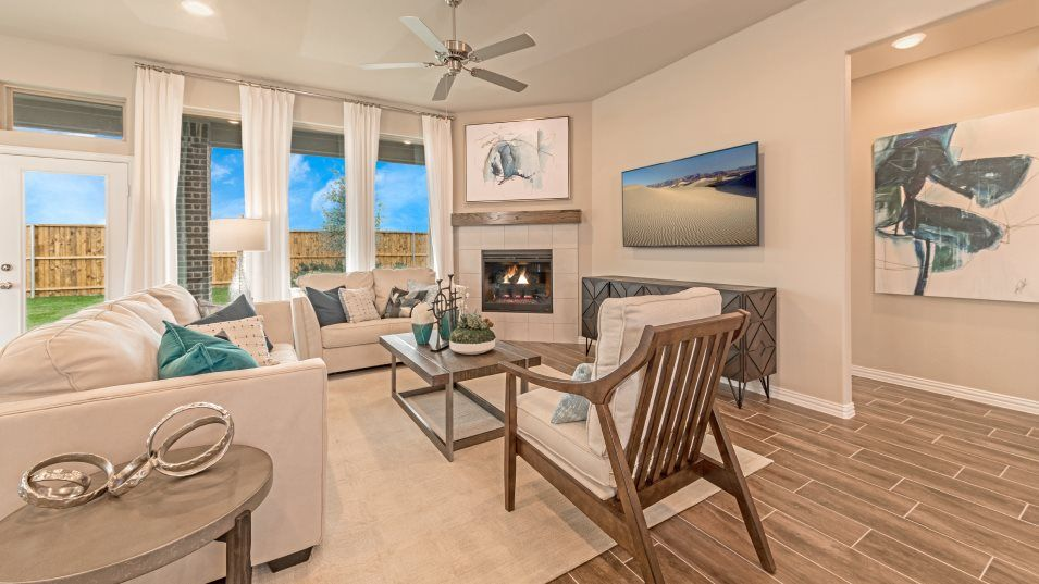 Hills of Crown Ridge Rosso Family Room:Come together with friends and family around the cozy fireplace found in the open concept living are