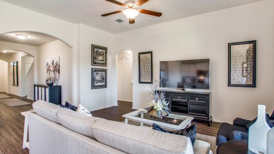Hillstone Pointe 40s & 50s Family Room:The family room has ample space for furniture, a cozy fireplace and back patio access.e to unwind wi